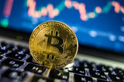 Vượt ngưỡng 7,000 USD, đồng tiền Bitcoin lên đỉnh 9 tháng