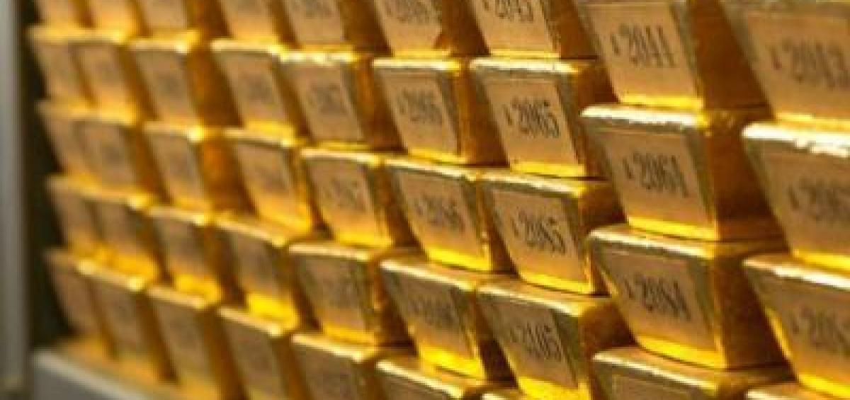 Vàng thế giới suy yếu sau cuộc họp Fed